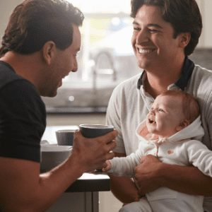 couple in their new home playing with baby| The Home Loan Process | VRM Lending LLC | vrmlending.com