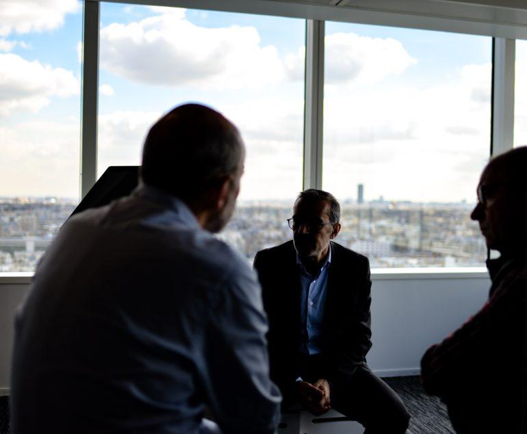 4 people having a meeting