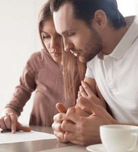 couple looking at vrm lending home buyer checklist| Pre-Approval vs. Pre-Qualification - Page 2