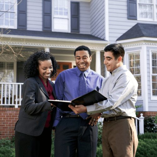 real estate agent and home buyers talking