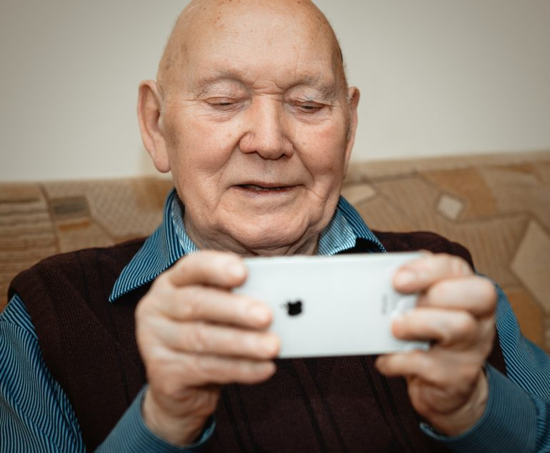 senior man on iphone