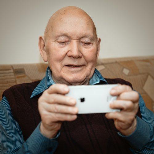 senior man on iphone